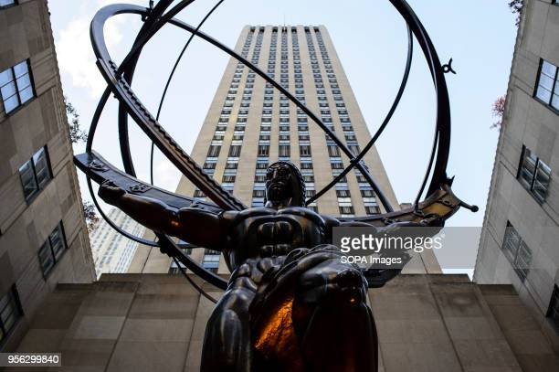 The bronze statue of Greek mythological figure Atlas by artists Lee Lawrie and Rene Chambellan stands outside Rockefeller Center on 5th Avenue in...