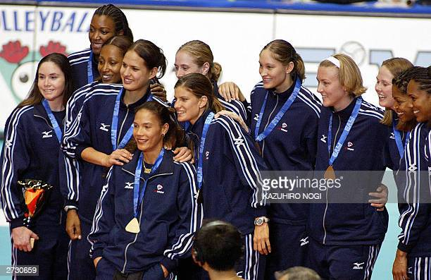 The bronze winning US volleyball team poses for photographers during the awards ceremony at the World Cup women's volleyball tournament at the...