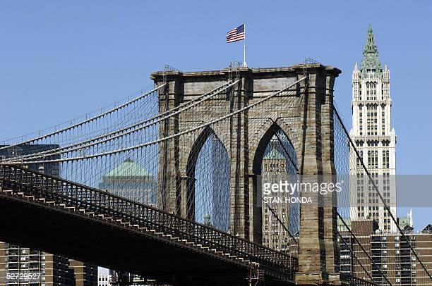 The Brooklyn Bridge and the historic Woolworth Building in Mahattan in this view from Brooklyn New York 14 April 2005 Located in Manhattan and...