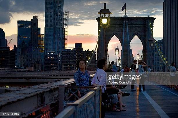 The Brooklyn Bridge at dusk on the walkway with the Beekman Tower in the background