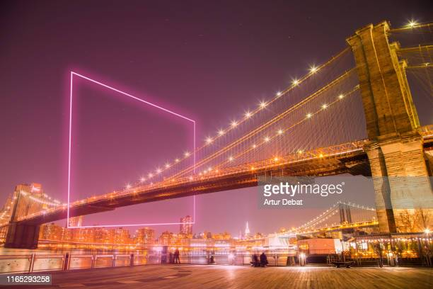 the brooklyn bridge creative picture at night with geometric lit neon. - us kultur stock-fotos und bilder