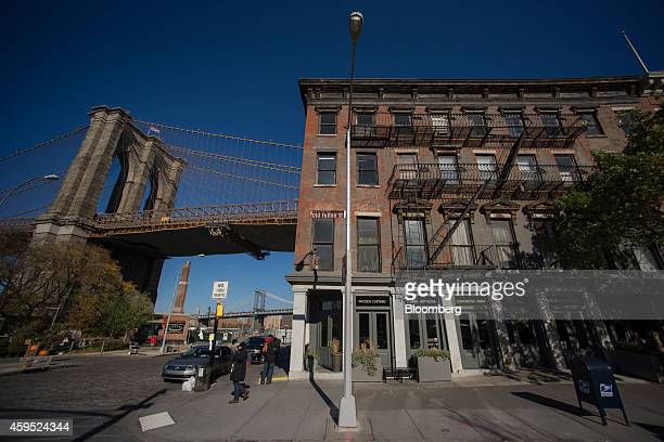 The Brooklyn Bridge is seen from Old Fulton Street in the DUMBO neighborhood in the Brooklyn borough of New York US on Saturday Nov 15 2014 DUMBO an...