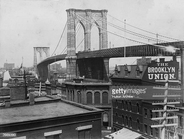 The Brooklyn Bridge over the East River, New York, between the boroughs of Brooklyn and Manhattan, shortly after its completion when it was the...