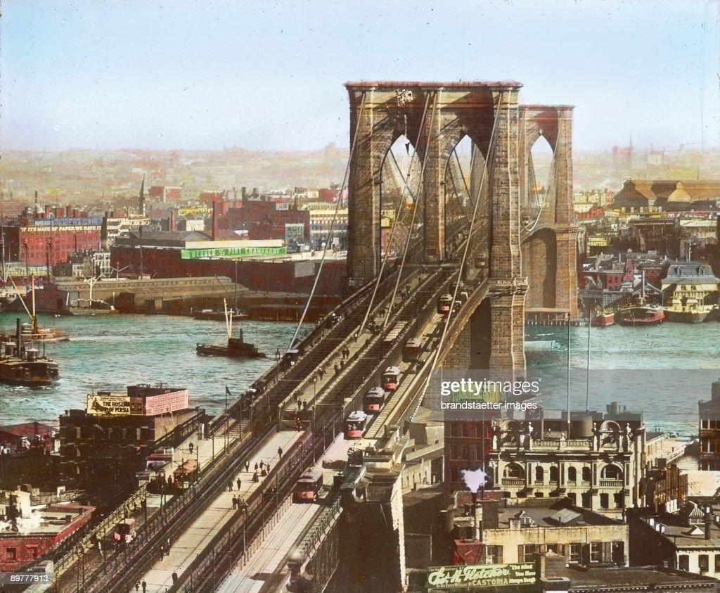 The Brooklyn Bridge spanning the East River. New York. Hand-colored lantern slide. Around 1890. : News Photo