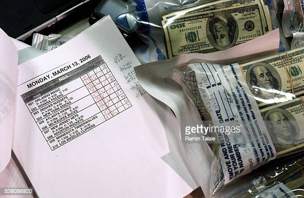 The Brooklyn District Attorney's office presents evidence for arrest of 10 men in an illegal sports gambling operations includes about $300000 in...
