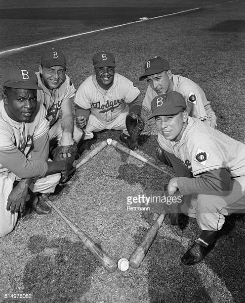 The Brooklyn Dodgers a team hard at work during their spring training sessions is shown in between shaping up Members of the Dodger 1952 infield are...