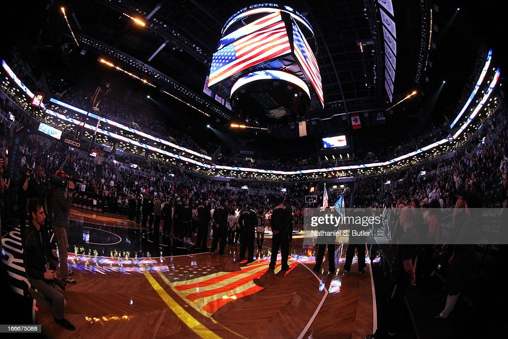 The Brooklyn Nets and the Washington Wizards observe a moment of silence for those injured and killed due to the bombing at the Boston Marathon earlier today on April 15, 2013 at the Barclays Center in the Brooklyn borough of New York City.