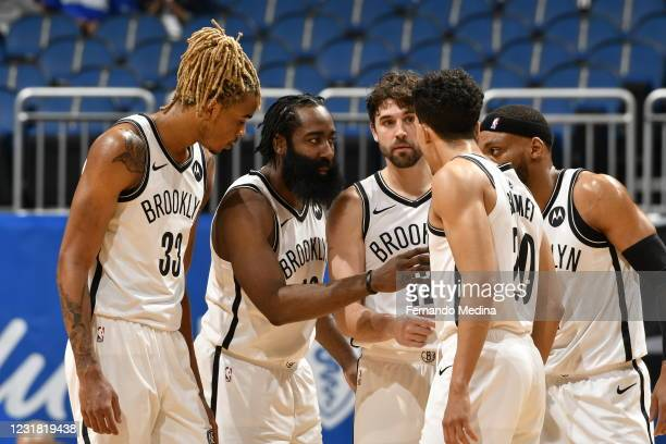 The Brooklyn Nets huddle up during the game against the Orlando Magic on March 19, 2021 at Amway Center in Orlando, Florida. NOTE TO USER: User...
