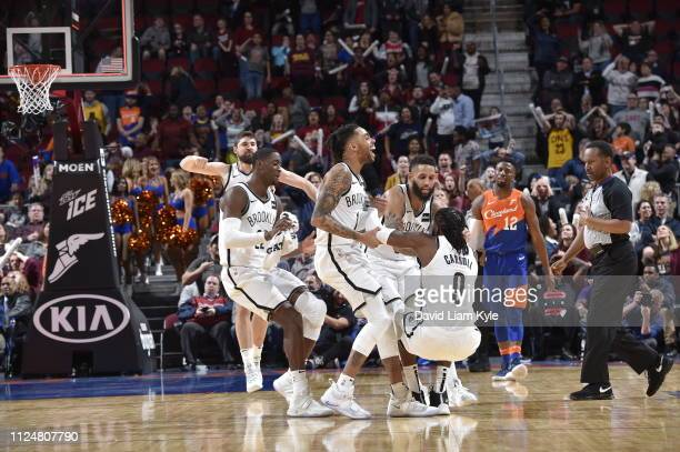 The Brooklyn Nets react after DeMarre Carroll of the Brooklyn Nets shoots the ball to send the game into triple overtime against the Cleveland...