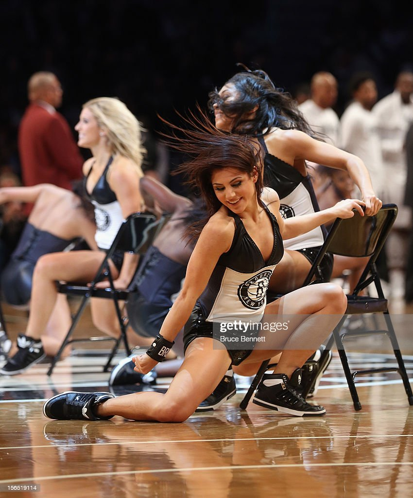 The Brooklynettes entertain the crowd during a timeout in the game between the Brooklyn Nets and the Boston Celtics at the Barclays Center on November 15, 2012 in the Brooklyn borough of New York City.