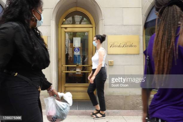The Brooks Brothers logo is engraved on a plaque in front of a closed store along the Magnificent Mile on July 08, 2020 in Chicago, Illinois. The...