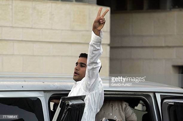 The brother of Israeli assassin Yigal Amir waves to rightwing supporters as he gets into a minivan carrying Amir's newborn son out of the Hasharon...