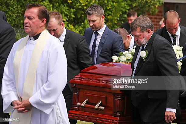The brother of Phillip Hughes Jason Hughes and father Gregory Hughes carry the coffin with Australian cricket captain Michael Clarke during the...