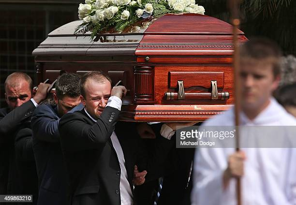The brother of Phillip Hughes Jason Hughes carries the coffin with Australian cricket captain Michael Clarke behind him during the Funeral Service...