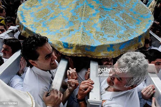 CONTENT] The brotherhood members carry the heavy throne and enter the narrow door of the Church during the Easter in Malaga Spain 9 April 2007