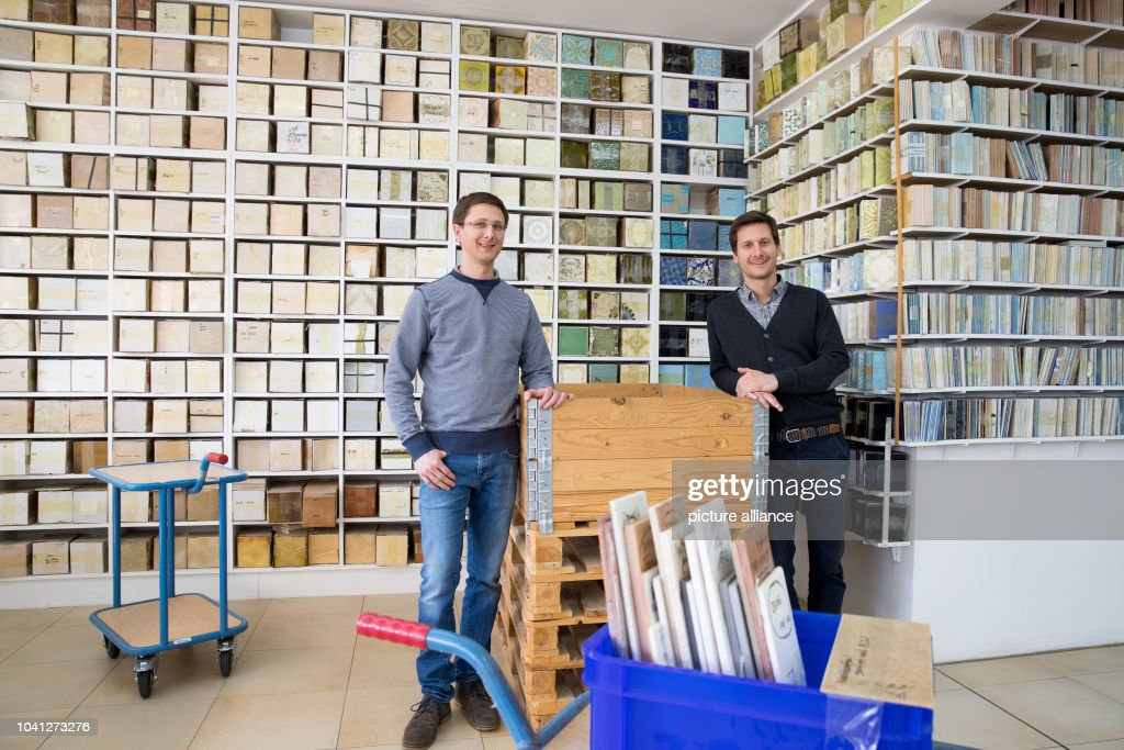 The brothers felix and jan schittek pose in a storage room for Fliesen schittek