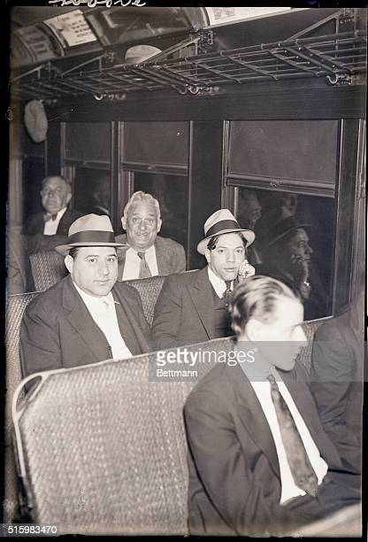 6/20/1933 The brothers Fiore and Edward Grimaldi two of three men with Death in Sing Sing prison are shown here with a guard on a train bound for...