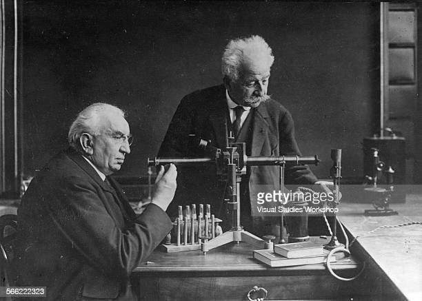 The brothers Louis and Auguste Lumiere famous French scientists who are credited to be the first filmmakers in history in their workshop Lyons France...
