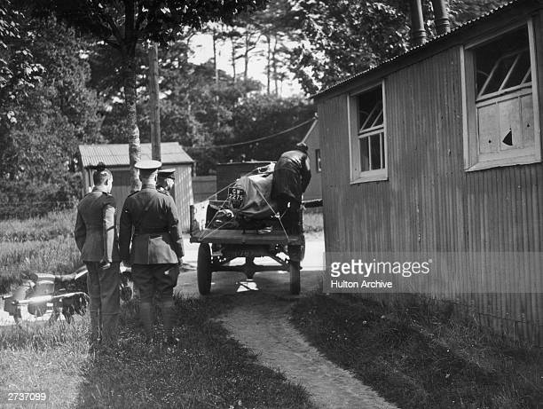 The Brough Superior motorcycle owned by T.E. Lawrence , aka Lawrence Of Arabia, is unloaded at the hospital at Bovington Camp in Dorset, 21st May...