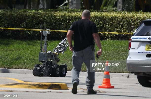The Broward Sheriff's Office bomb squad deploys a robotic vehicle to investigate a suspicious package in the building where Rep Debbie Wasserman...