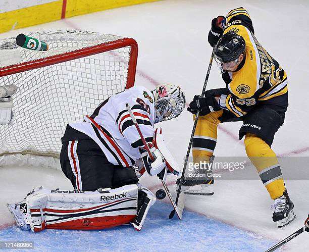 The Bruins Brad Marchand can't stuff the puck by Chicago goalie Corey Crawford in the second period The Boston Bruins hosted the Chicago Blackhawks...