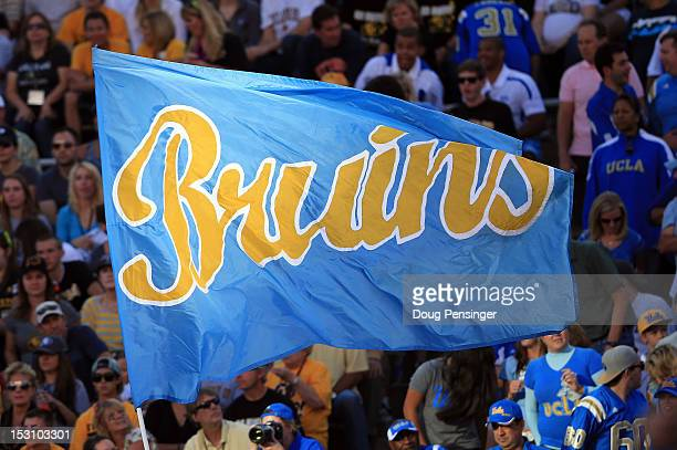 The Bruins flag flies as the UCLA Bruins score a touchdown against the Colorado Buffaloes at Folsom Field on September 29 2012 in Boulder Colorado...