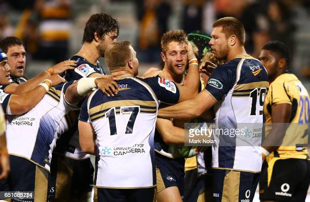 The Brumbies celebrate a try by Kyle Godwin during the round three Super Rugby match between the Brumbies and the Force at GIO Stadium on March 10,...
