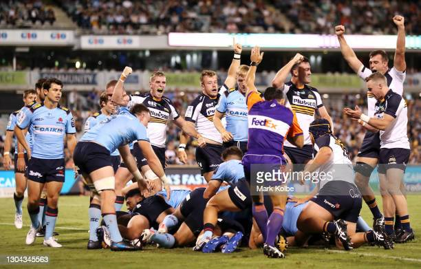 The Brumbies celebrate a try during the round two Super RugbyAU match between the Brumbies and the Waratahs at GIO Stadium, on February 27 in...