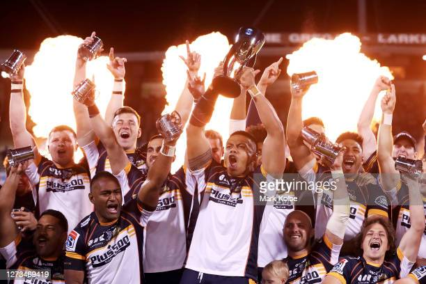 The Brumbies celebrate during the trophy presentation after winning the Super Rugby AU Final between the Brumbies and the Reds at GIO Stadium on...