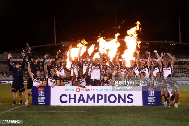 The Brumbies celebrate during the trophy presentation after winning the Super Rugby AU Grand Final between the Brumbies and the Reds at GIO Stadium...