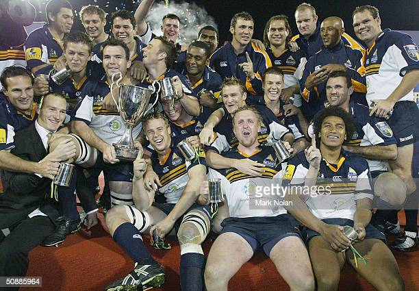 The Brumbies celebrate winning the Super 12 Rugby Final between the ACT Brumbies and the Crusaders at Canberra Stadium May 22, 2004 in Canberra,...