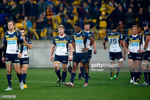 The Brumbies leave the field dejected following the Super Rugby Semi Final match between the Hurricanes and the Brumbies at Westpac Stadium on June...