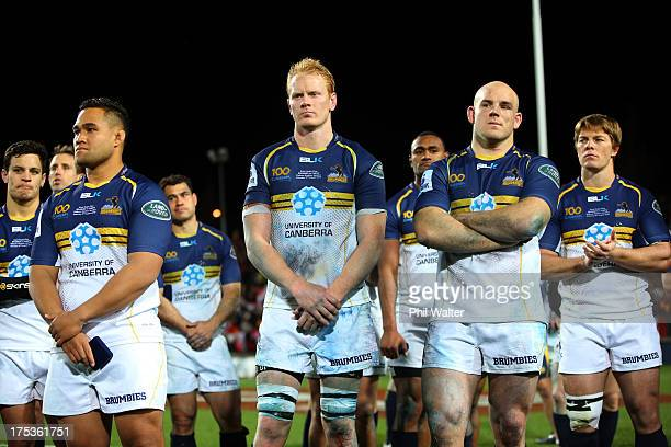 The Brumbies stand dejected following the Super Rugby Final match between the Chiefs and the Brumbies at Waikato Stadium on August 3 2013 in Hamilton...