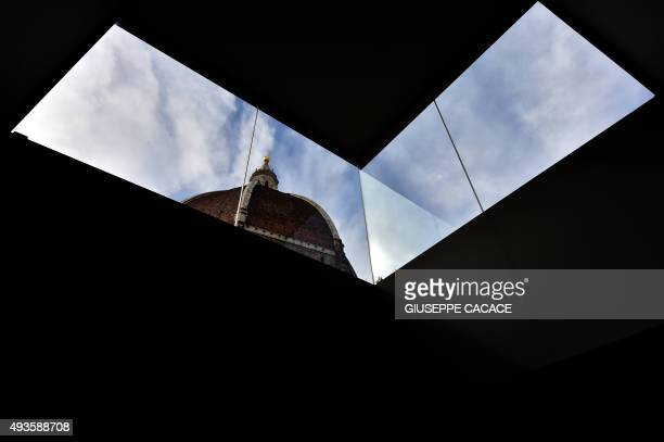 CAPTION === The Brunelleschi Dome of Florence's cathedral is seen through a window of the new Museo dell'Opera del Duomo in Florence on October 21...