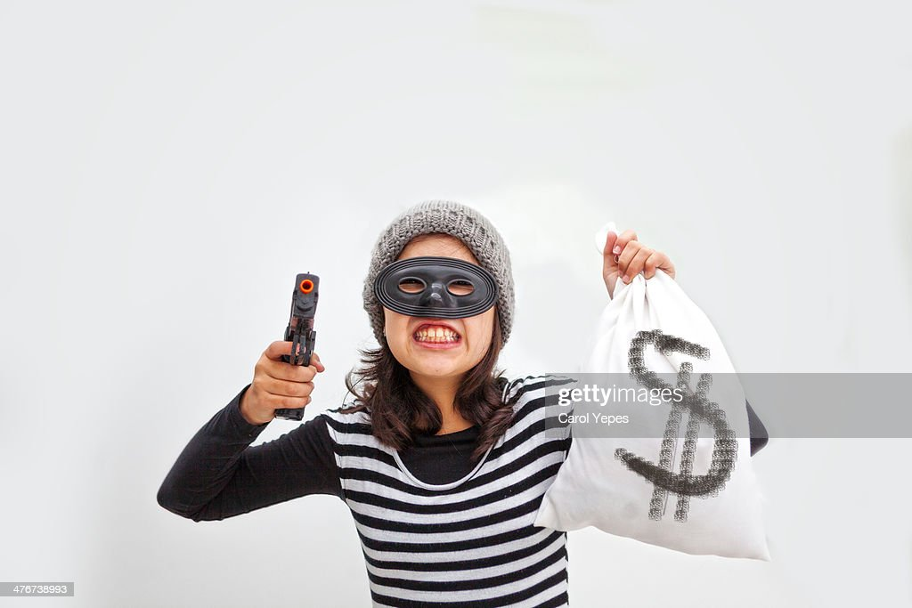The brunette thief : Stock Photo
