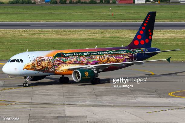 AIRPORT BRUSSELS BELGIUM The Brussels Airlines A320 Tomorrowland colored aircraft arriving back from Spain at Brussels airport