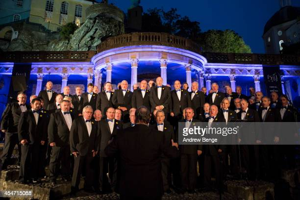 The Brythoniaid Welsh Male Voice Choir perform on stage for Festival No6 at the central piazza on September 5 2014 in Portmeirion United Kingdom
