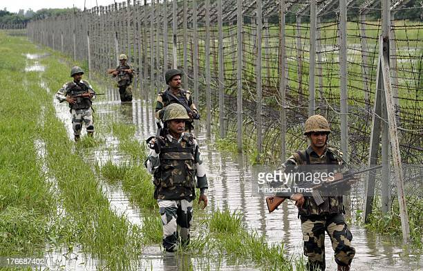 The BSF personnels patrolling on the fence at International Border Suchetgarh about 30 km from Jammu on August 17 2013 in Jammu India Since last 11...