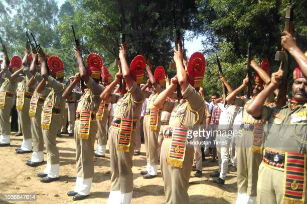 The elder son of martyred Border Security Force Head Constable Narendra Singh doing the last rites at his native village Thana Kalan of district...