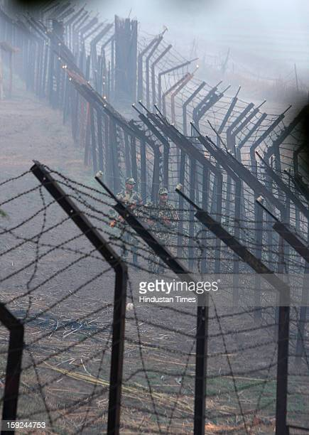 The BSF troops patrolling along with the border fence in the riverine area along the border with Pakistan in Ajnala sector on January 10 2013 about...