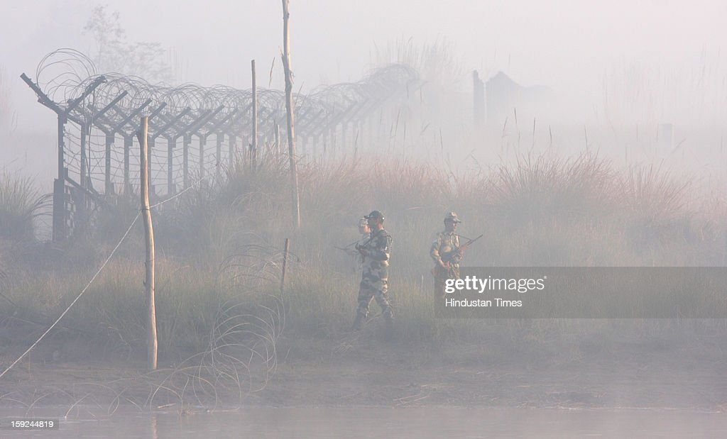 The BSF troops patrolling in thick fog in the riverine area along with the border of Pakistan in Ajnala sector on January 10, 2013 about 45 KMS from Amritsar, India. The situation between the two countries become tense after the Killing of two Indian soldiers by infiltrating Pakistani troops in Jammu and Kashmir.