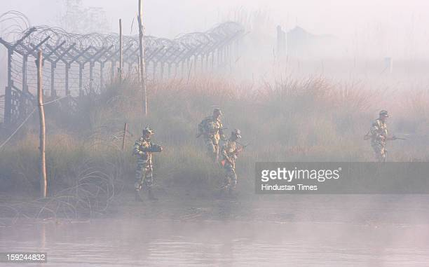 The BSF troops patrolling in thick fog on a boat in the riverine area along the border with Pakistan in Ajnala sector on January 10 2013 about 45 KMS...