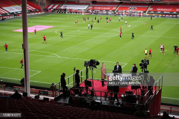 The BT Sport television platform overlooks the pitch as players warm up ahead of the English Premier League football match between Sheffield United...