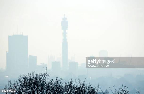 The BT Tower and buildings in central London are seen through the mist from Parliament hill in north London on January 24 2017 Britain's Met Office...
