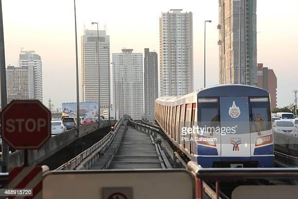 The BTS sky train drives along a railway track in Bangkok.