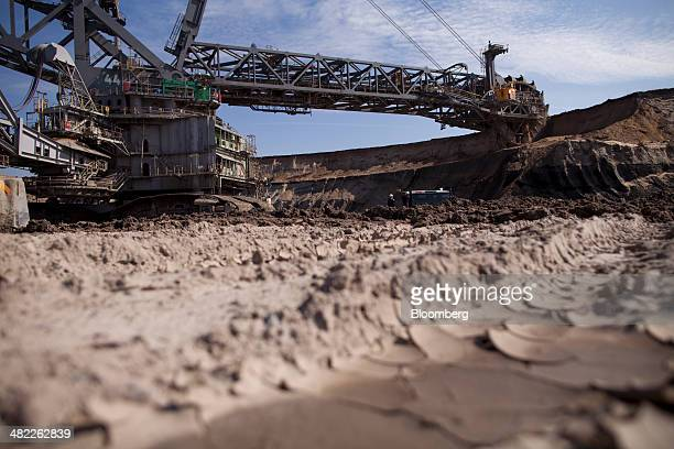 The bucket wheels of a giant excavator cut into the earth during lignite also known as brown coal digging operations at the open pit mine operated by...