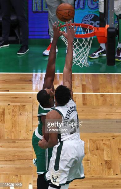 The Bucks trailed by two points with 0.4 seconds left in the game. They inbounded the ball with a long pass under the basket, where Giannis...