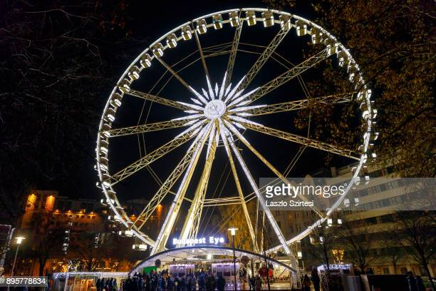 The Budapest Eye with a big snowflake Christmas decoration is seen at Erzsébet tér on December 17 2017 in Budapest Hungary Budapest is a popular...