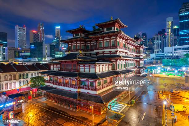 the buddha tooth relic temple.this is a buddhist temple on chinatown district of singapore,asia - treasuregold stock pictures, royalty-free photos & images