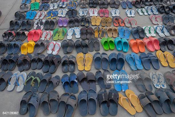 WAT DHAMMAKAYA BANGKOK THAILAND The Buddhist faithful leave their shoes outside a temple